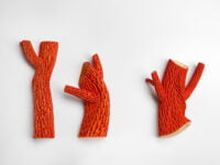 Hybrid red tree brooches by Catherine Truman
